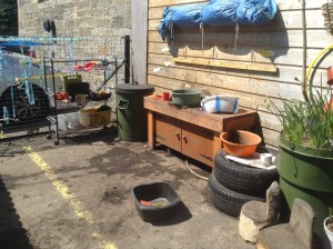 Our new mud kitchen - developed in response to children's ideas Parents supplied old kitchen ware for equipment